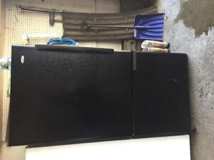 Black fridge over freezer