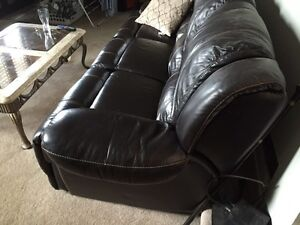 1 yr old brown leather wall away couch
