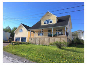 RENOVATED CORNER BROOK HOME WITH GARAGE AND INCOME. NEG ON PRICE