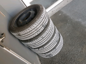 4 Like new Firestone tires on rims for sale