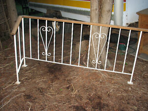 WROUGHT IRON L SHAPE RAILING WITH OAK BANNISTER