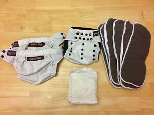 Three Rock-A-Bums all-in-one one-size diapers