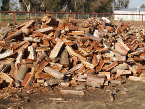 HARDWOOD FIREWOOD CUT AND SPLIT PRICE REDUCED .