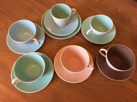 Pool cup and saucers plus one plate