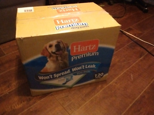 New box of puppy pee pads.