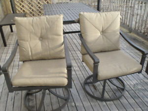 Patio Dining Table and Two Swivel Chairs / cushions