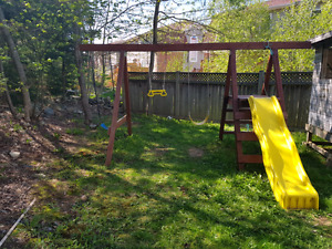 SWINGSET  AND WOODEN PLAYHOUSE