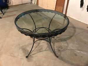 Iron round table with thick glass top.