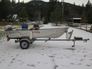 12-FOOT ALUMINUM LUND BOAT AND MOTOR - $4250.00
