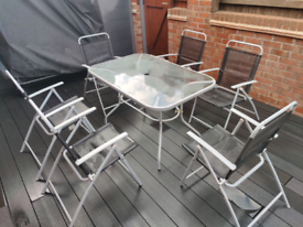 Garden furniture set 6 folding chairs and glass table