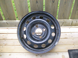 """Four 14"""" Ford Steel Rims"""