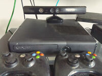 Mint conditions Xbox 360 with Kinect + 2 controlers + games