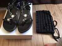 Black jewelled sandals and handbag.