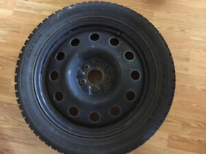Four winter tires on rims 245/45R18 and 225/45R18