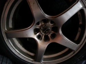 4 bolt multi fit 5 spoke rims and tires(like new)RTX brand