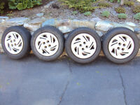Four P185/65 R14 Tires, 2 Winter, 2 All Seasons, On Rims