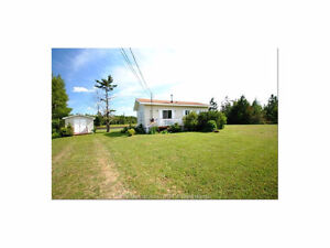 WATERFRONT cottage for sale in Shediac Bridge