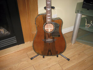 Keith Urban acoustic electric with super wood grain finish.