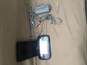 Wii u with game pad, and 4 games downloaded on