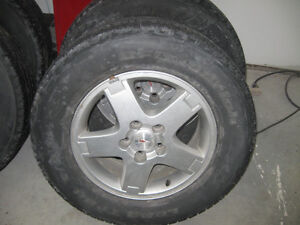 Four (4) 235/65R16 M/S Tires and Rims 5x114.3 Bolt Pattern