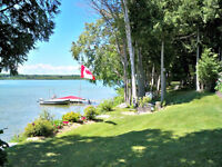 Beautiful lot, Stunning Waterfront. Move-In ready Bungalow.