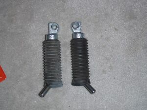 set of Harley control pegs and a shifter peg