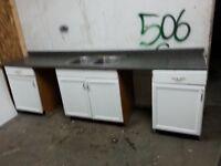 Countertop, sink, & cupboards
