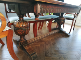 Solid oak vintage carved dining table with 8 chairs
