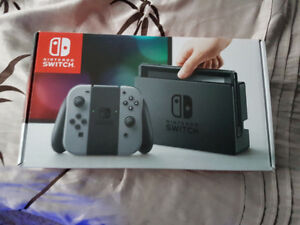 Brand New Nintendo Switch with Box and Accessories