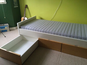 IKEA Single bed with 3 storage boxes.