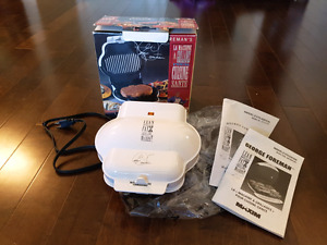 "George Foreman ""lean mean fat reducing grilling machine!"" grill"