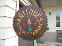 antiques and collectibles sign on large saw blade / chain
