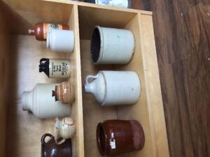 Crock jugs, ginger beer, demijohns and old bottles