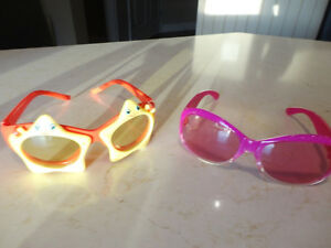 2 pairs Of Child Sunglasses - Each the same size $2.00 ea.