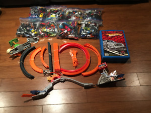 Hotwheels, tracks, carrying case and Monster trucks!!