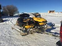 Pair of 700 Summit Skidoos on tilting trailer