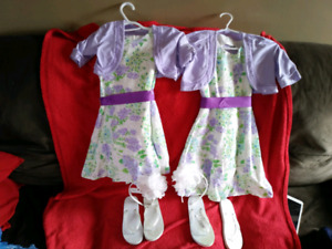 2 matching girls dresses with accessories