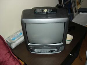 Memorex TV VCR- Comes with remote and box full of movies