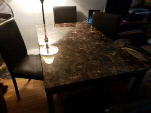 Beautiful Dining Table with 4 black faux leather chairs