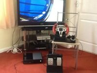 XBOX ONE AND STEERING WHEEL WITH GAMES