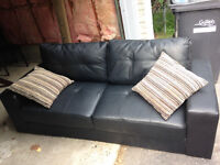 Barely used black leather couch