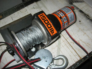 12 volt winch AS NEW with a new heavy duty  strap included
