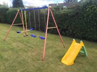 Childs swings, slide, and bicycle