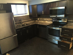Bright, Modern 2 bed 2 bath LEGAL Basement Suite