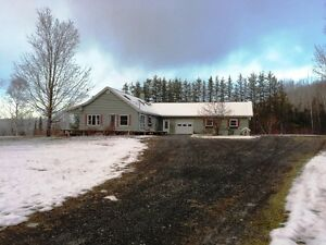 BEAUTIFUL 4 BEDROOMS ON ALMOST 5 ACRES LOCATED IN NEW DENMARK