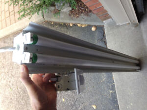 4' fluorescent ballast with bulbs and sensor switch.