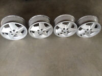 4 sunfire rims ,muffler and tires