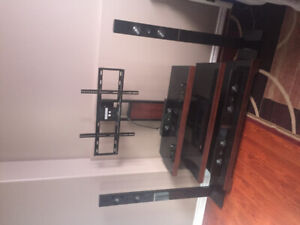 Tv stand with surround sound
