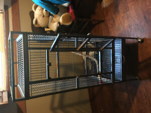 Large metal bird cage on stand with wheels