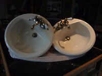 2 Oval bathroom sinks with faucets